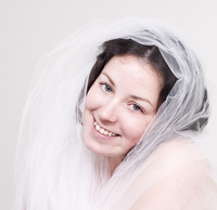A veil becomes this bride.