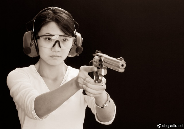 In a relaxed firing stance with a large-frame revolver.