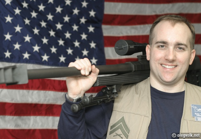 Kane with a bolt action rifle.