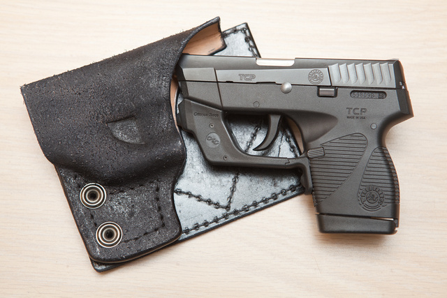 Taurus TCP738 with Crimson Trace laser in a Dragon Leather