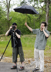 Holding an umbrella over my camera, while Matt uses it.
