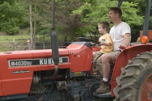 Tom and Tim, driving a tractor